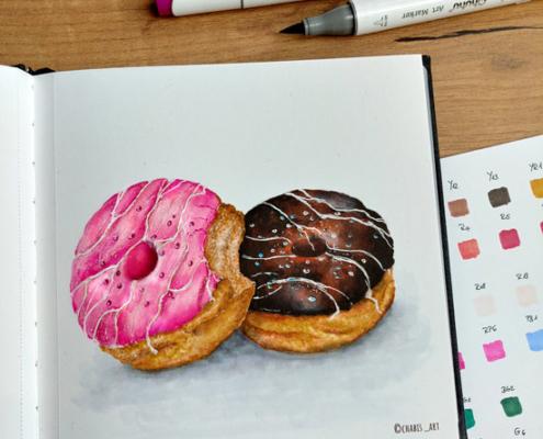 Zwei Donuts mit Ohuhu-Markern gemalt